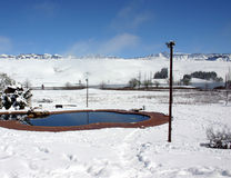 Snow landscape. Swimming pool surrounded by snow Royalty Free Stock Photo