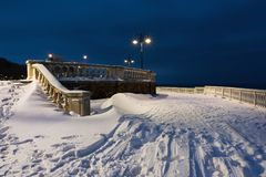 Snow landscape in Burgas Sea Garden, near the Culture center Sea Casino at blue hour. Royalty Free Stock Images