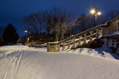 Snow landscape in Burgas Sea Garden, near the Culture center Sea Casino at blue hour. Stock Photo