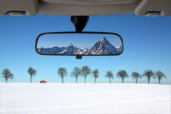 Snow landscape in the car rear mirror Stock Image
