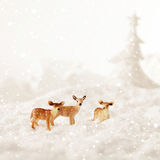 Snow landscape with deers Stock Photos