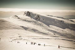 Snow landscape and ski slope. Wintertime skislope landscape in the Romanian mountaines Stock Photos
