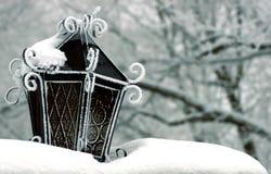 Snow Lantern. A lantern in the snow with a slight bluish tone Royalty Free Stock Photos