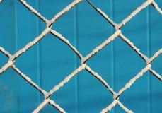 Snow lattice on blue background. Winter snow lattice on blue background Royalty Free Stock Photos