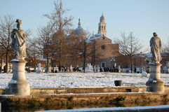 Snow in the lawn and the church of Santa Giustina in Padua. Royalty Free Stock Image