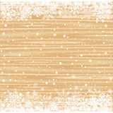 Snow and light brown wood background Stock Images