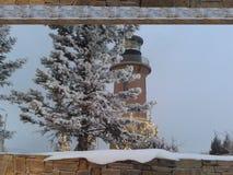 Snow lighthouse stock image