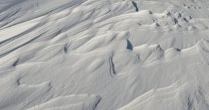 Snow like waves frozen from the winter winds. Horizontal Stock Photo