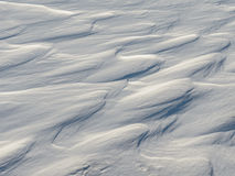 Snow like waves frozen from the winter winds. Stock Photo