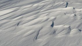Snow like waves frozen from the winter winds. Horizontal Royalty Free Stock Photo