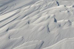 Snow like waves frozen from the winter winds. Horizontal Royalty Free Stock Image
