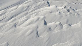 Snow like waves frozen from the winter winds. Horizontal Stock Photos