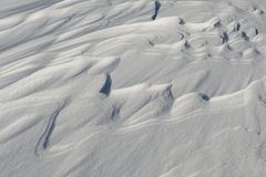 Snow like waves frozen from the winter winds. Horizontal Royalty Free Stock Images