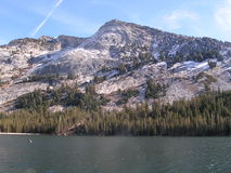 Snow Lingers Above Treeline. Granite peak holds last of the winters snowfall Stock Images