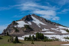 Snow Lingers on the Trail to Watchman Overlook. In Crater Lake Stock Photos