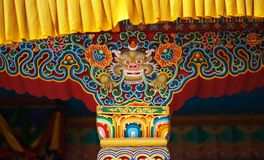 Snow lion in an element of a decoration of monastery. The traditional image of a snow lion in an element of a decoration of the Buddhist monastery Stock Images