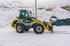 Snow Loader require a chain on the wheel. Jungfrau,Switzerland-Jan 4,2017: Snow Loader require a chain on the wheel to prevent slipping when the car is running Stock Photo