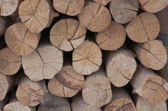Snow log stack lumber in winter. Woodpile of pine Royalty Free Stock Photos