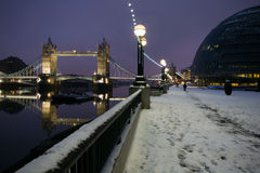 Snow  in London. Rare occasion to see snow in London, famous landmarks in a winter's landscape: Tower bridge, Mayor's office Stock Photo