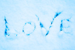 Snow love. Imprint of the word love on pure snow Royalty Free Stock Photography