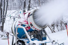 Snow machine blowing artificial snow Royalty Free Stock Photography