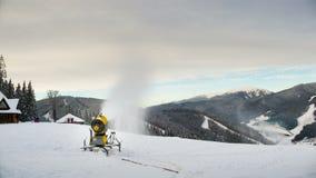 Snow machine gun on a ski slope. Timelapse stock video