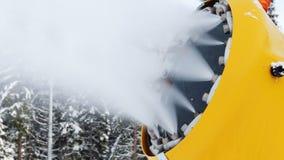 Snow machine gun on a ski slope stock footage
