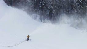 Snow machine gun on a ski slope stock video footage