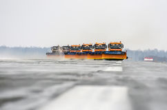 Snow machines on the asphalt runway rain snow removal. Russia, Tyumen city, Airport Roschino 13 March 2014 Royalty Free Stock Images