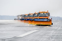 Snow machines on the asphalt runway rain snow removal. Russia, Tyumen city, Airport Roschino 13 March 2014 Stock Images