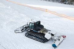Snow machines on the snow-covered road ski resort. Stock Image
