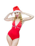 The Snow Maiden.The blonde in a cap of Santa Claus Royalty Free Stock Photo