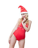 The Snow Maiden. The blonde in a cap of Santa Claus. Stock Photos