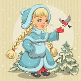 Snow Maiden in blue fur coat feeds bullfinch Stock Image
