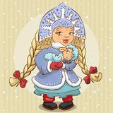 Snow Maiden in blue fur coat holds a lamb Royalty Free Stock Photos