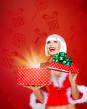 Snow maiden with a christmas gift with magic shining Royalty Free Stock Photo
