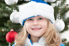 Snow Maiden at the christmas tree Royalty Free Stock Image