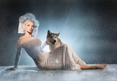 Snow maiden with dog Royalty Free Stock Photography