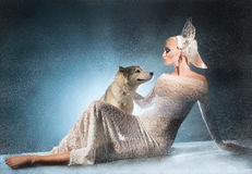 Snow maiden with dog Royalty Free Stock Image