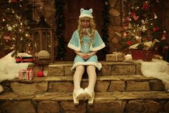 Snow Maiden on doorstep of house decorated in Christmas style Royalty Free Stock Photo