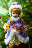 Snow Maiden, fur-tree toy on the branches of a live Christmas tree Royalty Free Stock Images