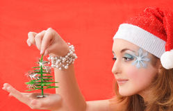 Snow Maiden look at Christmas tree Stock Images