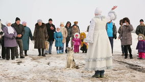 Snow Maiden performs with trained dog. On holiday in Russia stock footage