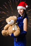 Snow maiden presents a toy bear Royalty Free Stock Images