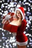 Snow Maiden in red suit holding a gift for New year 2018,2019 Stock Photos