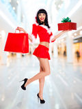 Snow maiden with shopping bags and box gift Royalty Free Stock Photo