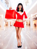 Snow maiden with shopping bags Royalty Free Stock Images