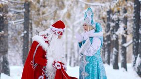 Snow Maiden is surprised to see the gifts in Father Frost is red bag