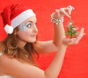 Snow Maiden touch top Christmas tree Royalty Free Stock Photos