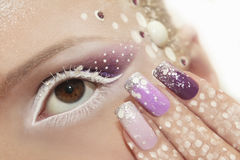 Snow makeup and manicure. stock photo